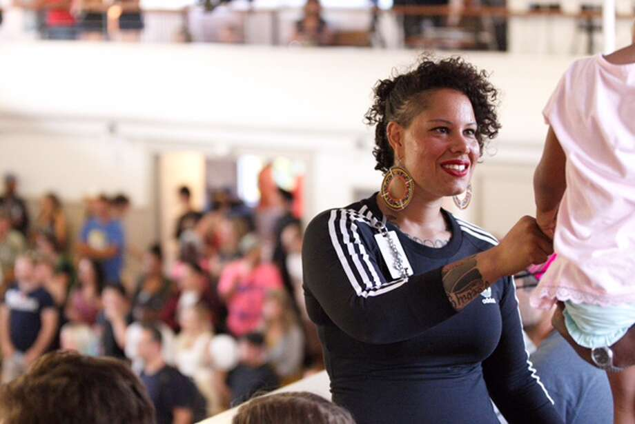 Nikkita Oliver, greets supporters at Washington Hall in Seattle, Aug. 1, 2017. Photo: GRANT HINDSLEY