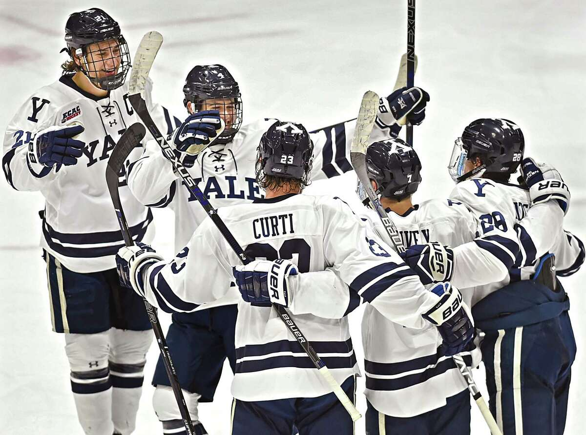 Yale celebrates their fifth goal against Rensselaer, Friday, December 9, 2016, scored by sophomore left wing Joe Snively (7) in a 7-3 win at Ingalls Rink in New Haven. Snively, senior center John Hayden, and sophomore right wing Ted Hart scored 2 goals each and freshman defenseman Matt Foley put the Bulldgos on the board 00:52 seconds into the game. (Catherine Avalone/New Haven Register)