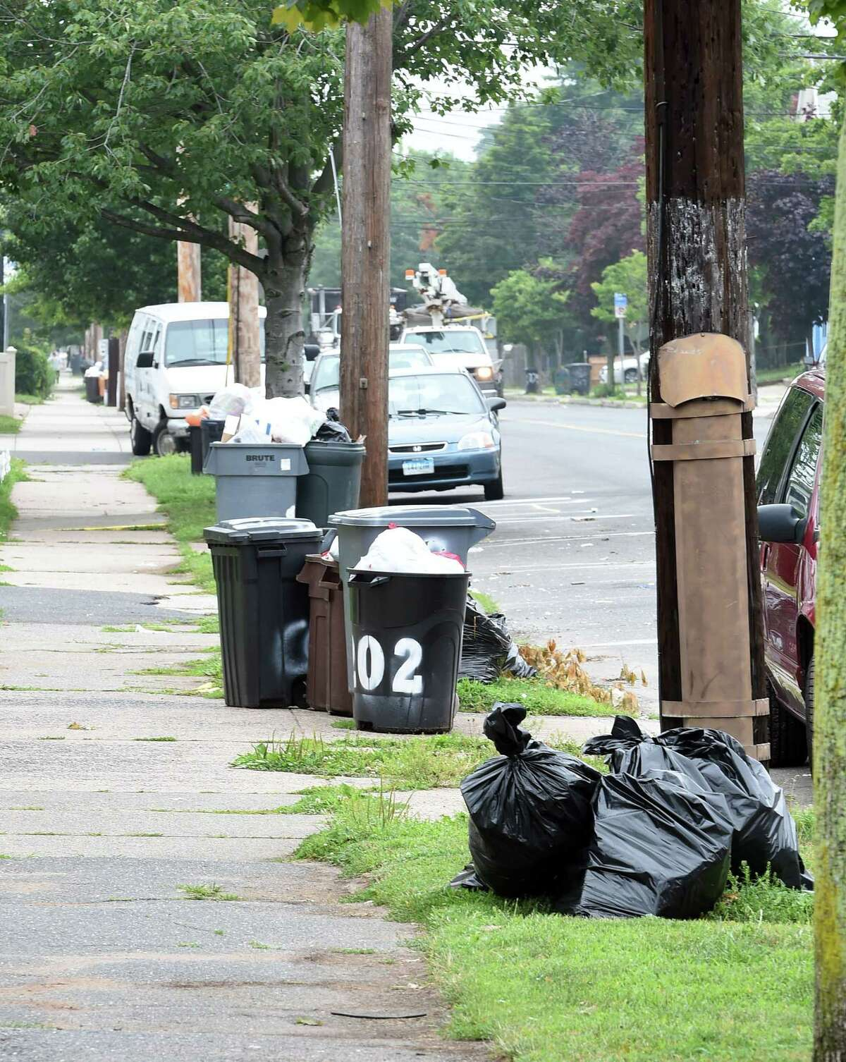 Weekly trash piled in front of homes in West Haven in this file photo.