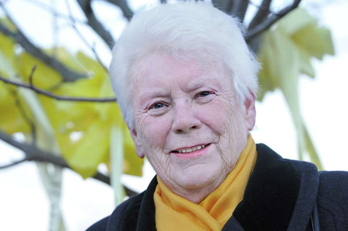 Ann McLaughlin, the founder of East Hampton's Yellow Ribbon Welcome Home Program is The Middletown Press Person of the Year 2014. McLaughlin is photographed at the village center green wearing a yellow scarf, a Christmas gift from her grandson Army Sergeant Arron McLaughlin. Arron served in Iraq and received the Purple Heart following an injury during a tour in Afghanistan. Ann McLaughlin felt a soldier's return home from war deserved a town-wide welcome home ceremony after her grandson returned home with little fanfare. Catherine Avalone - The Middletown Press