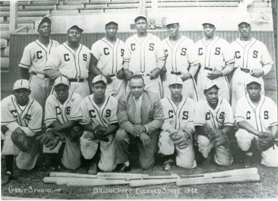 A 1942 photo of the Bridgeport Colored Stars, a semi-professional, all-African American team. Rufus Baker, a 1938 graduate of Fairfield's Roger Ludlowe High School, was playing for the Colored Stars when he was spotted by the New York Black Yankees, a Negro National League team, and signed as their shortstop. Photo: Contributed Photo / Connecticut Post Contributed