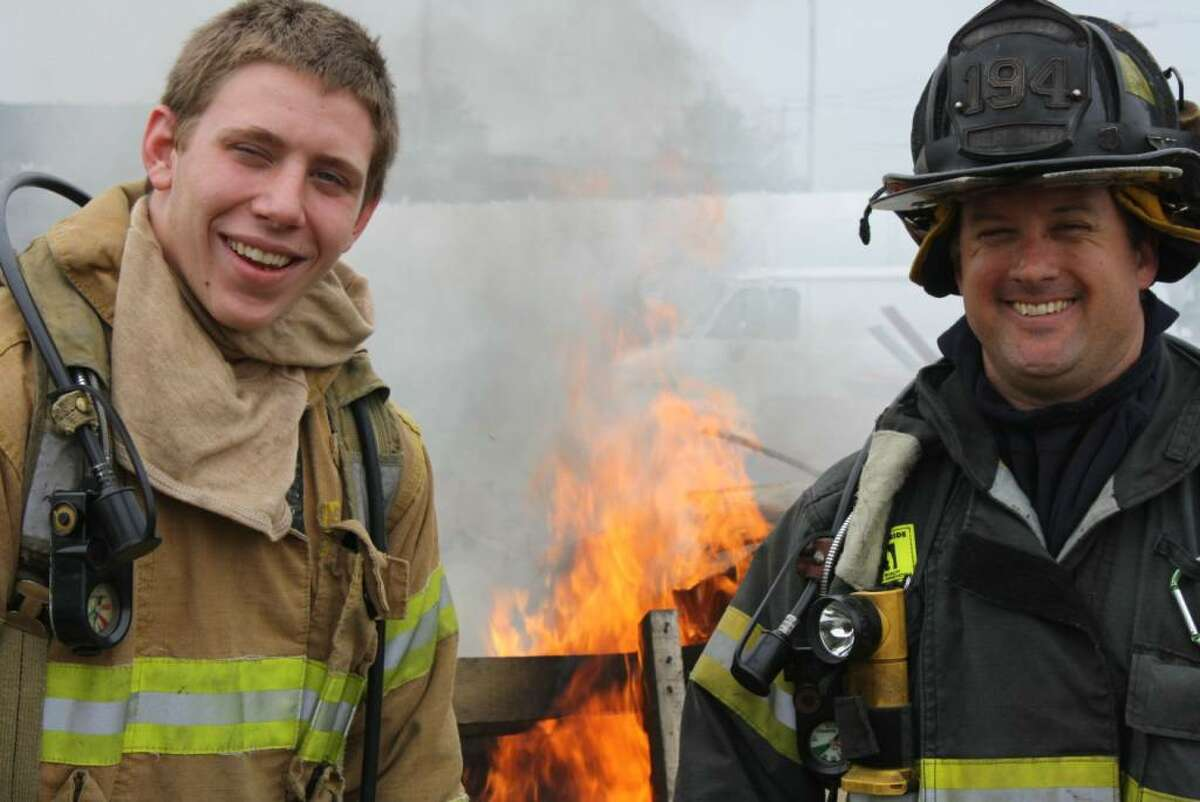 Anthony Wadelton, left, a Fairfield Ludlowe High School senior, with Firefighter Justin Greenhaw. Wadelton has spent an internship arranged by the Ludlowe College and Career Center with the Fire Department.