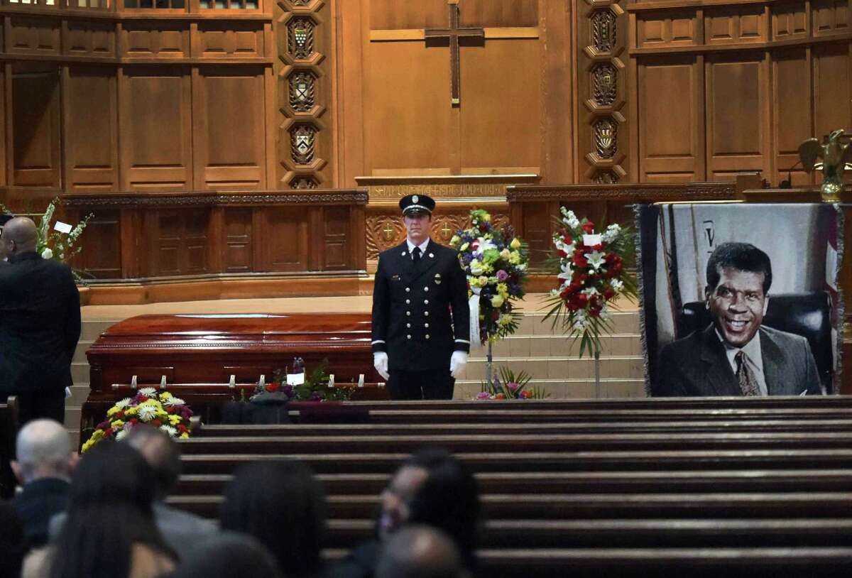 (Peter Hvizdak - New Haven Register) A New Haven firefighter standing as an honor guard by the casket of former New Haven Mayor John C. Daniels at Battell Chapel at Yale University in New Haven Friday morning, March 20, 2015 during the before the funeral service. Daniels served as New Haven mayor from 1990 - 1993.