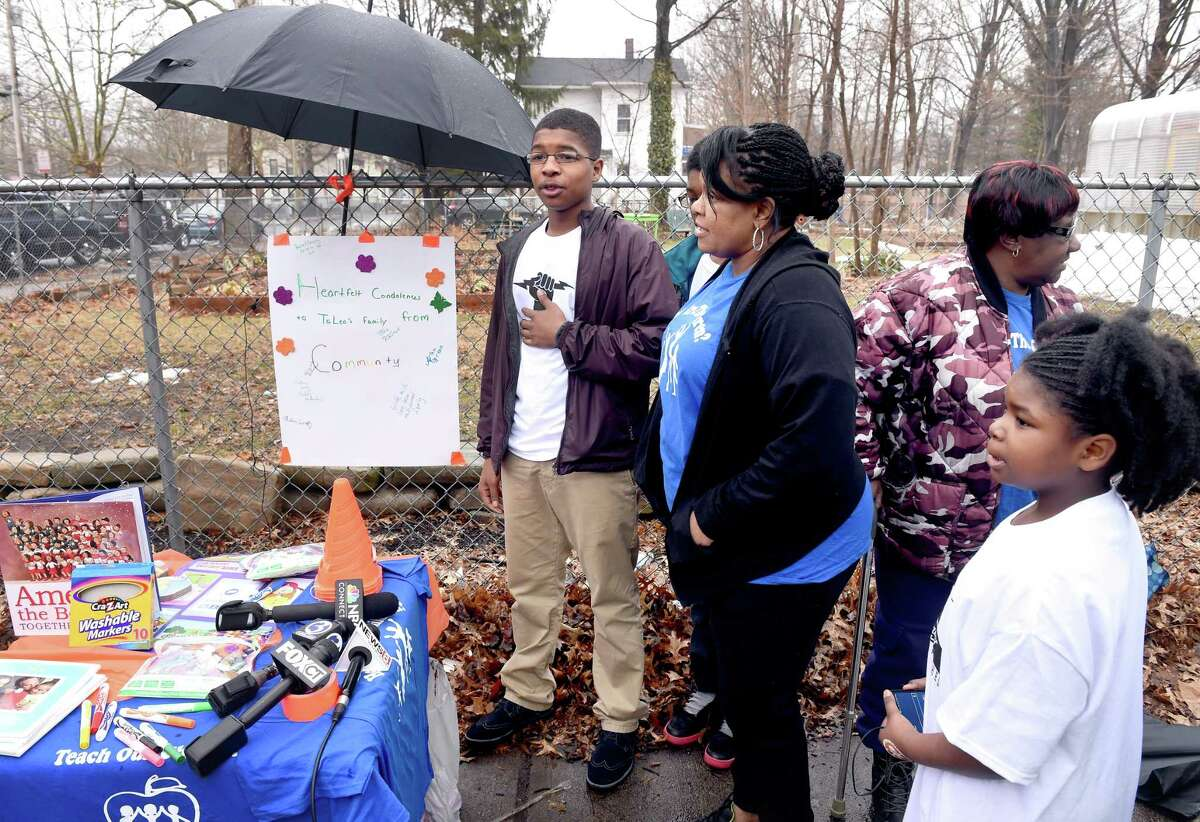 Isaiah Rutherford (center), 17, of Youth UnleashED speaks during a memorial to deceased third grader TeLea Turnage near Lincoln Bassett School in New Haven on 3/26/2015. Photo by Arnold Gold/New Haven Register agold@newhavenregister.com
