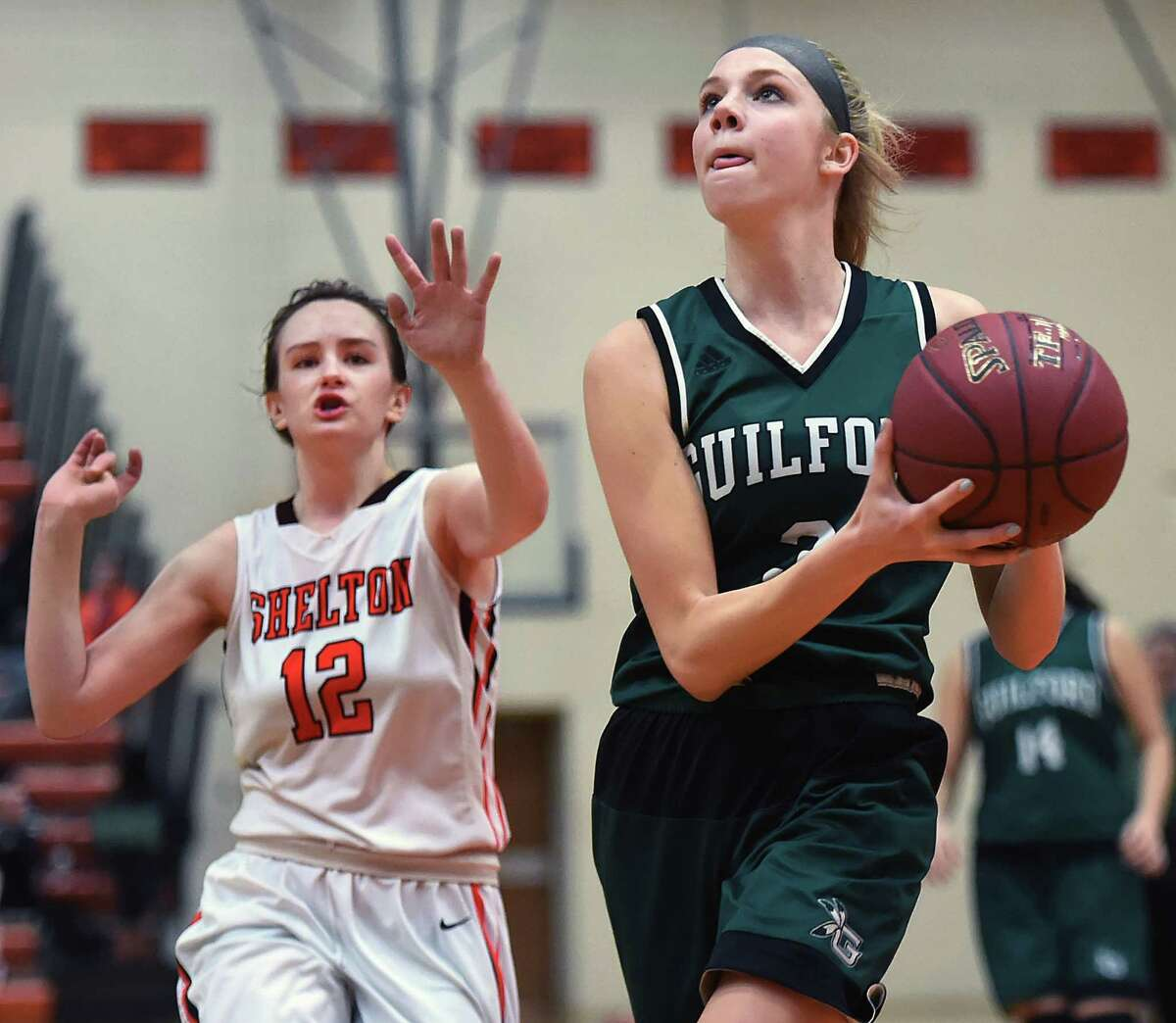 Guilford senior captain Camryn Craig drives past Shelton senior guard Emmeline Bronson on a fast break to the hoop as the Indians defeat the Gaelettes, 63 - 40, Friday, January 20, 2017, at the Vincent J. Murray Memorial Gym at Shelton High School. (Catherine Avalone/New Haven Register)