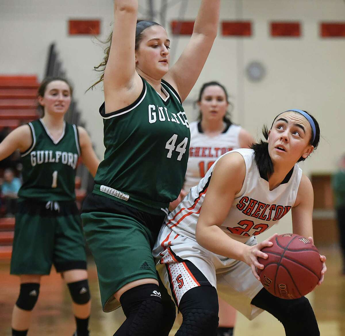Shelton junior forward Kayla Resto eyes the hoop as Guilford senior guard/forward Nicole Suchy is ready to block the shot as the Indians defeat the Gaelettes, 63 - 40, Friday, January 20, 2017, at the Vincent J. Murray Memorial Gym at Shelton High School. (Catherine Avalone/New Haven Register)
