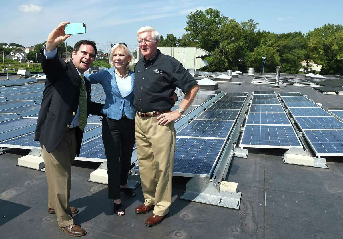 (Mara Lavitt ?' New Haven Register) August 6, 2014 New Haven Quality Hyundai held an event celebrating the placement of over 500 solar panels on the roof of the auto dealership. DEEP Commissioner Rob Klee takes a selfie with State Rep. Lonnie Reed of Branford, co-chair of the legislature's energy and technology committee, and Quality Hyundai owner Joe Blichfeldt, Sr. on the roof with the array. mlavitt@newhavenregister.com