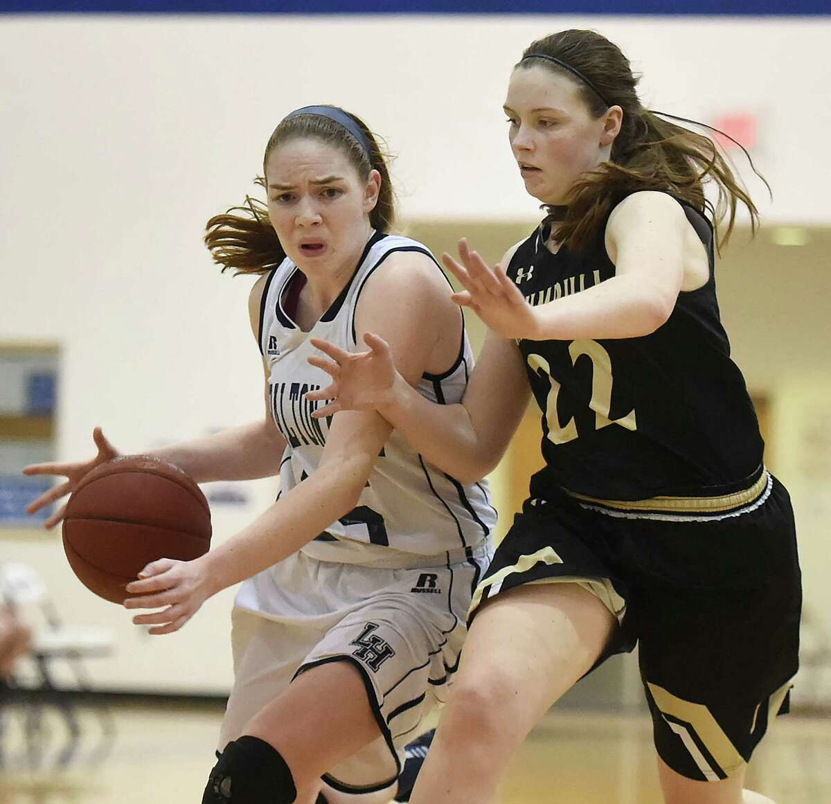 Trumbull junior Aisling Maguire pressures Lauralton Hall senior Trish Gildea as she drives to the hoop in a 59 - 50 win for the visiting Eagles, Wednesday, January 25, 2017, at the Lauralton Hall Athletic Center in Milford. (Catherine Avalone/New Haven Register)