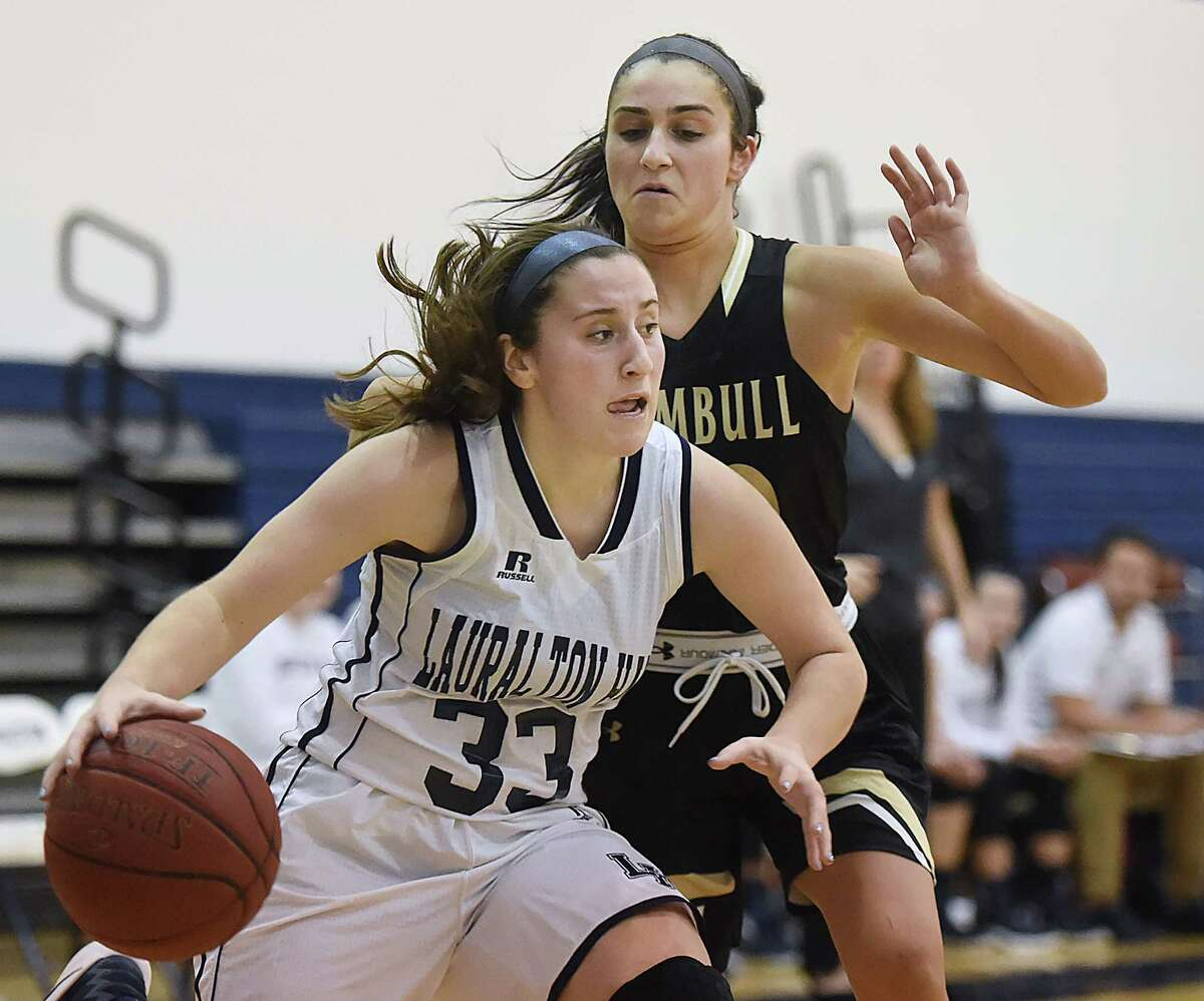 Trumbull senior Victoria Ray tries to avoid fouling Lauralton Hall sophomore Lauren Adams as makes a move to the hoop, in a 59 - 50 loss to the Eagles, Wednesday, January 25, 2017, at the Lauralton Hall Athletic Center in Milford. (Catherine Avalone/New Haven Register)