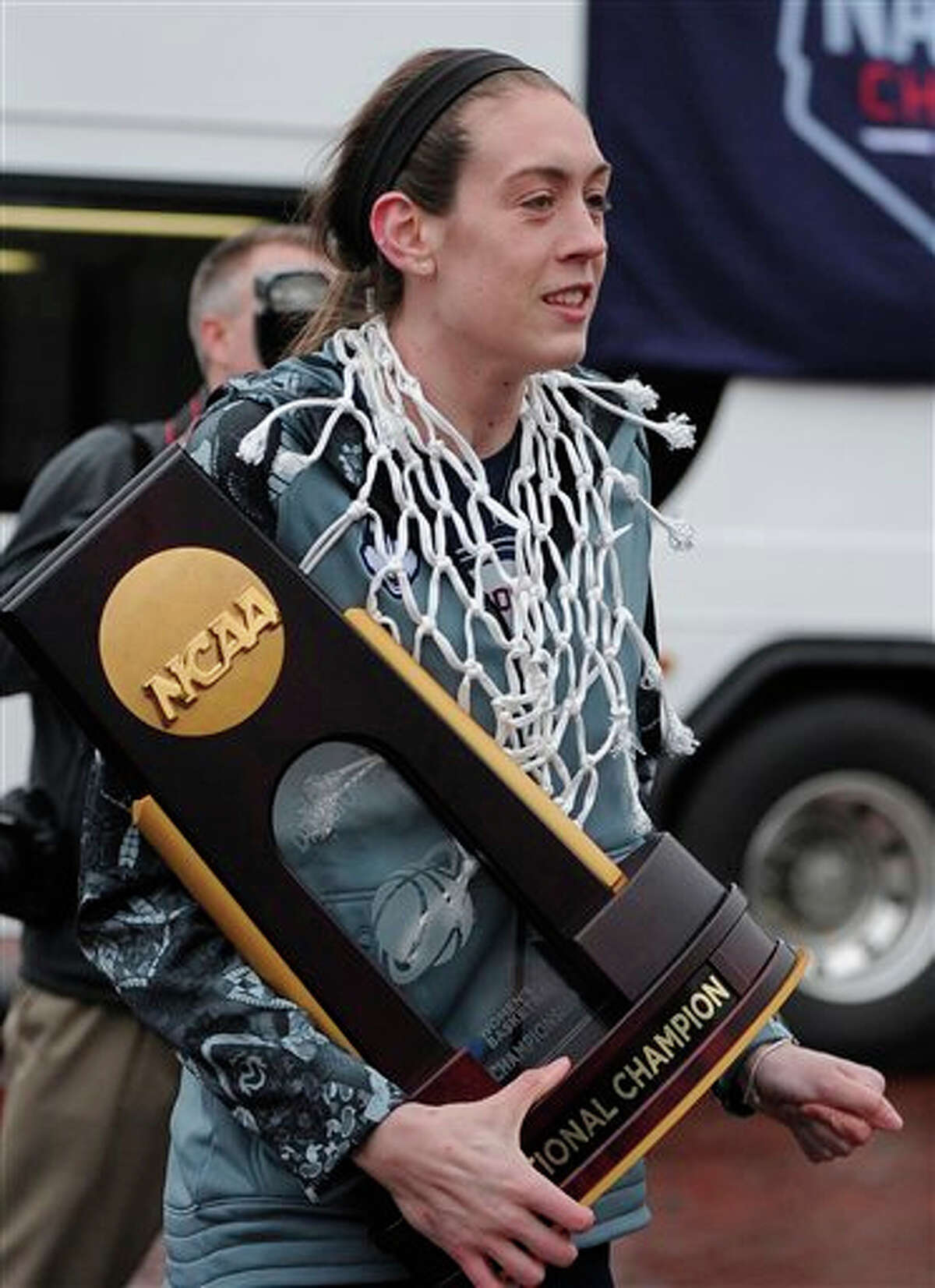 Connecticut's Breanna Stewart arrives at a rally on campus with her team to celebrate its 10th national title and third in a row, Wednesday, April 8, 2015, in Storrs, Conn.