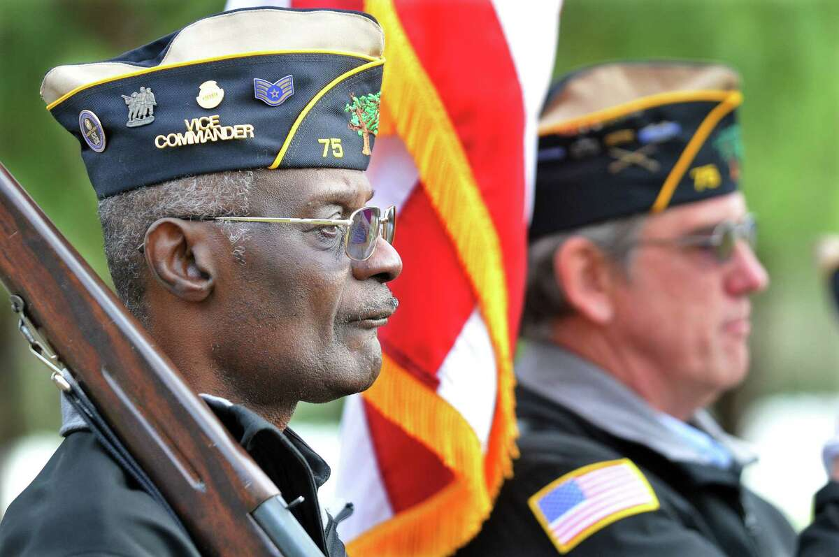 Middletown Vietnam veteran and American Legion Post 75 Vice Commander Larry Riley serves as Color Guard during the Veterans Day ceremony Monday afternoon at the State of Connecticut Veterans' Cemetery at 317 Bow Lane in Middletown. Catherine Avalone - The Middletown Press