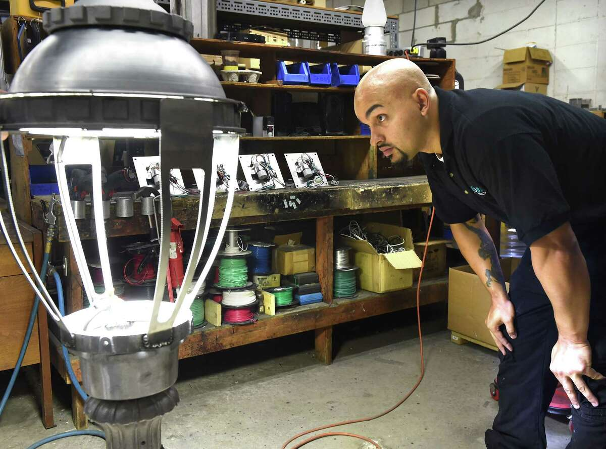 (Mara Lavitt ?' New Haven Register) August 22, 2014 North Branford The Pennsylvania Globe Gaslight Co. in North Branford manufactures street lights that are used all over the country. Neftali Alicea trouble-shoots a light fixture. mlavitt@newhavenregister.com