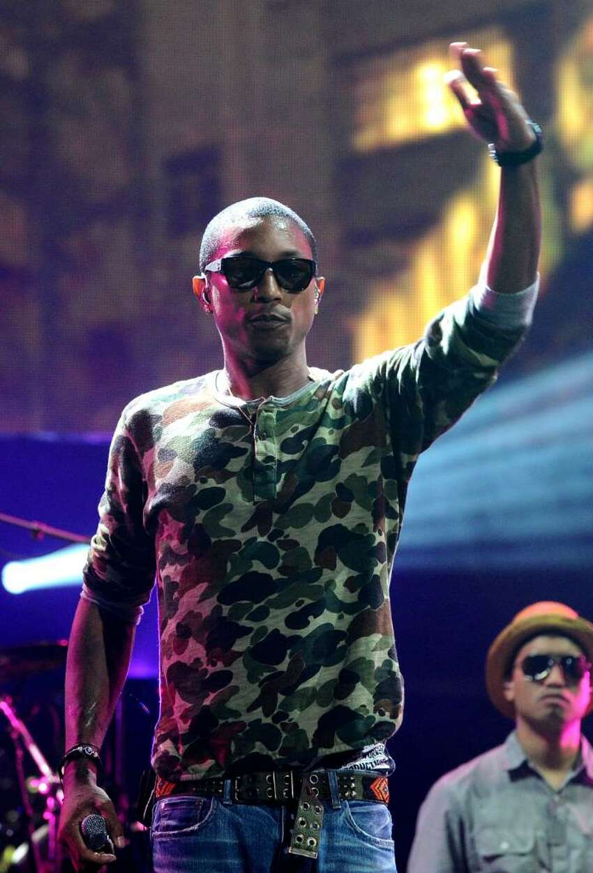 LOS ANGELES, CA - JUNE 14: Pharrell Williams of N.E.R.D performs onstage at the Activision E3 2010 preview held at Staples Center on June 14, 2010 in Los Angeles, California. (Photo by Michael Buckner/Getty Images for Activision) *** Local Caption *** Pharrell Williams
