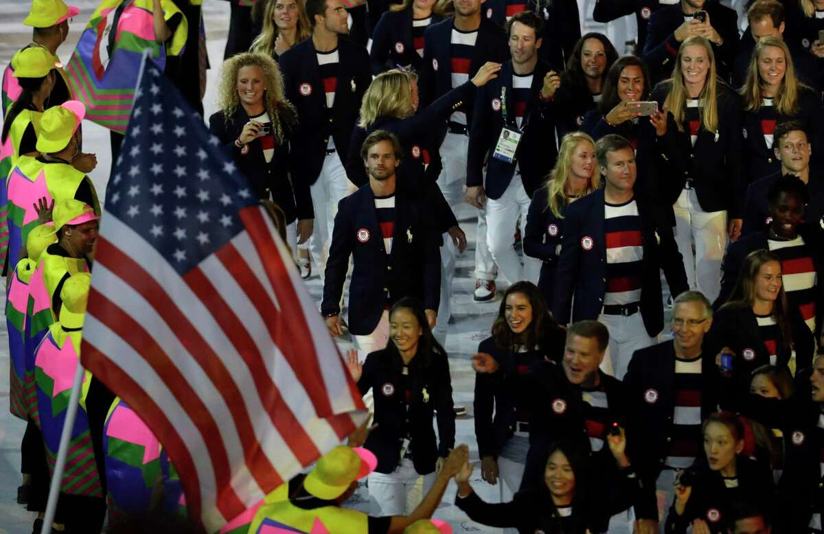 Members of the United States' team march in the arena during the opening ceremony for the 2016 Summer Olympics in Rio de Janeiro, Brazil, Friday, Aug. 5, 2016.