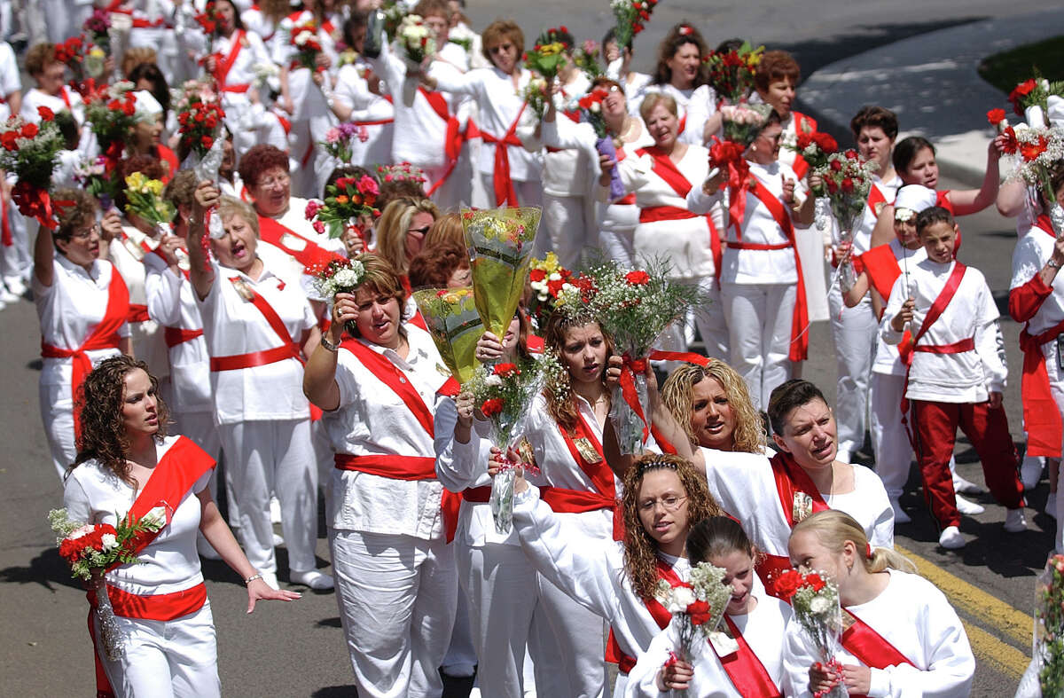 May 19, 2002 - The i Nuri run through the streets of Middletown at Feast of St. Sebastian (Irena Pastorello/The Middletown Press)