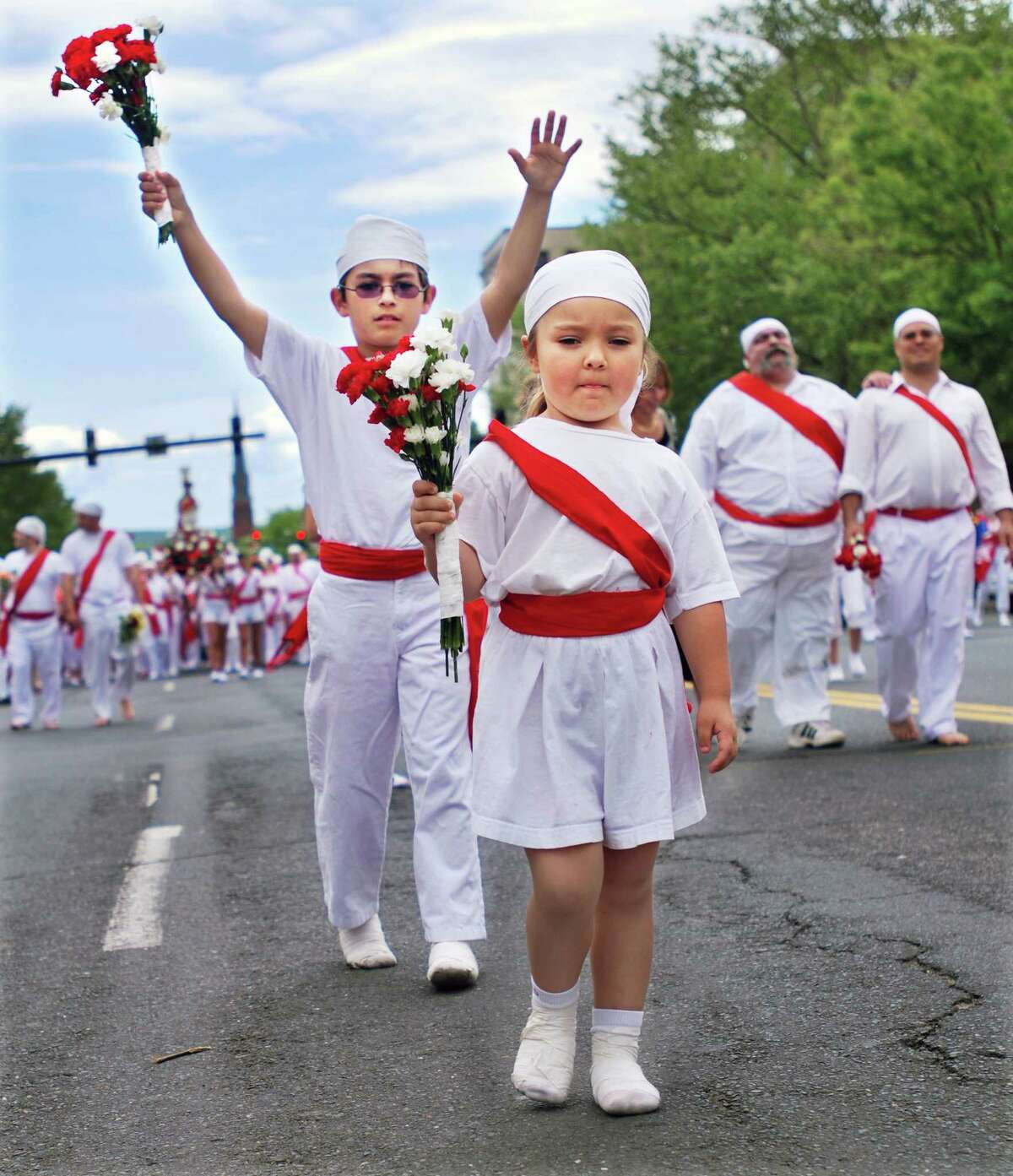 Christina Faraci and her brother, Dylan Faraci, march up Main Street during the i Nuri run at the St. Sebastian Feast in Middletown in this 2010 file photo. (Andrew Avalone/Special to the Press)