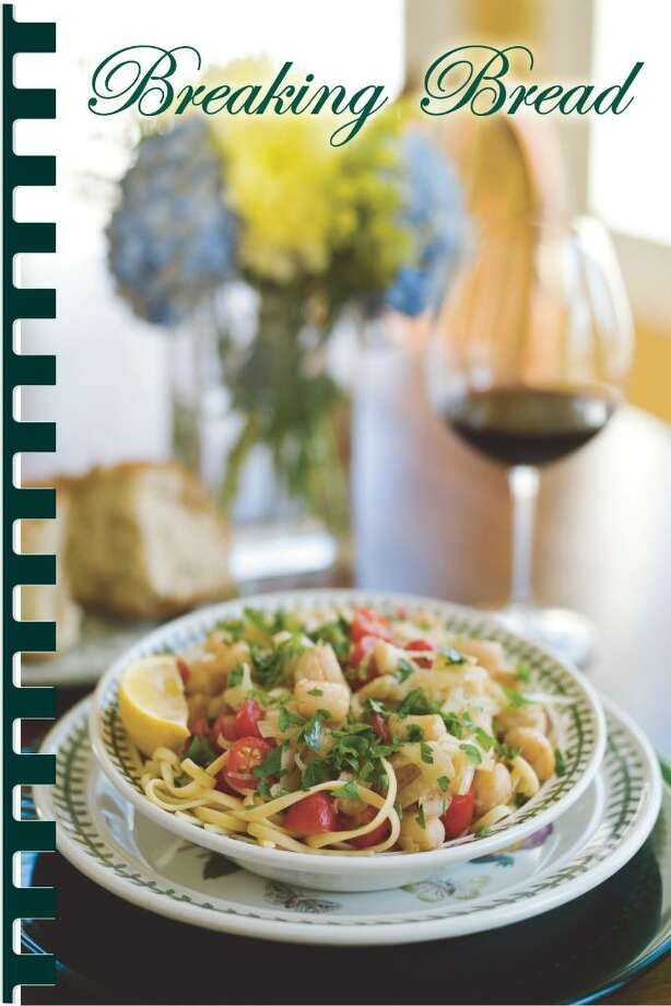 """ChiChi Ubina  Linguine with bay scallops, fennel and tomatoes appears on the cover of """"Breaking Bread,"""" a cookbook compiled by four local women to benefit the scholarship fund at St. Michael the Archangel parish in Greenwich. Photo: Contributed Photo / Greenwich Citizen"""