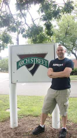 Executive Director Kyle Silver stands outside of Arch Street, the Greenwich teen center. Arch Street will be celebrating its 20th anniversary this fall. Photo: Contributed Photo / Greenwich Citizen