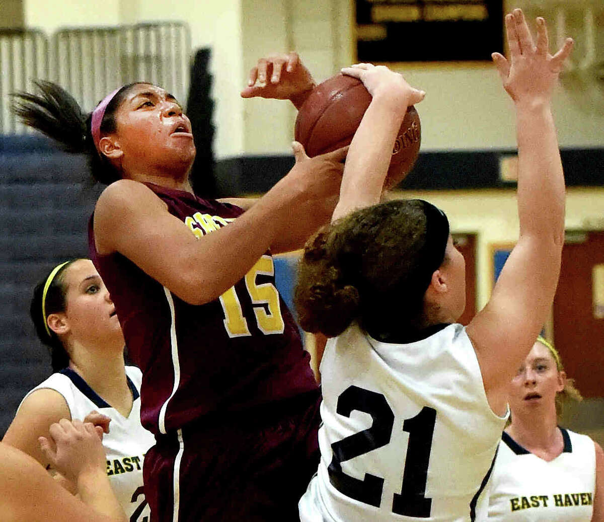 (Photo by Peter Hvizdak - New Haven Register) Joelle Mark Anthony of Sheehan H.S. has her shot blocked by Miranda Gladwin of East Haven H.S. during fourth quarter girls basketball action at East Haven H.S. Wednesday, December 10, 2014.
