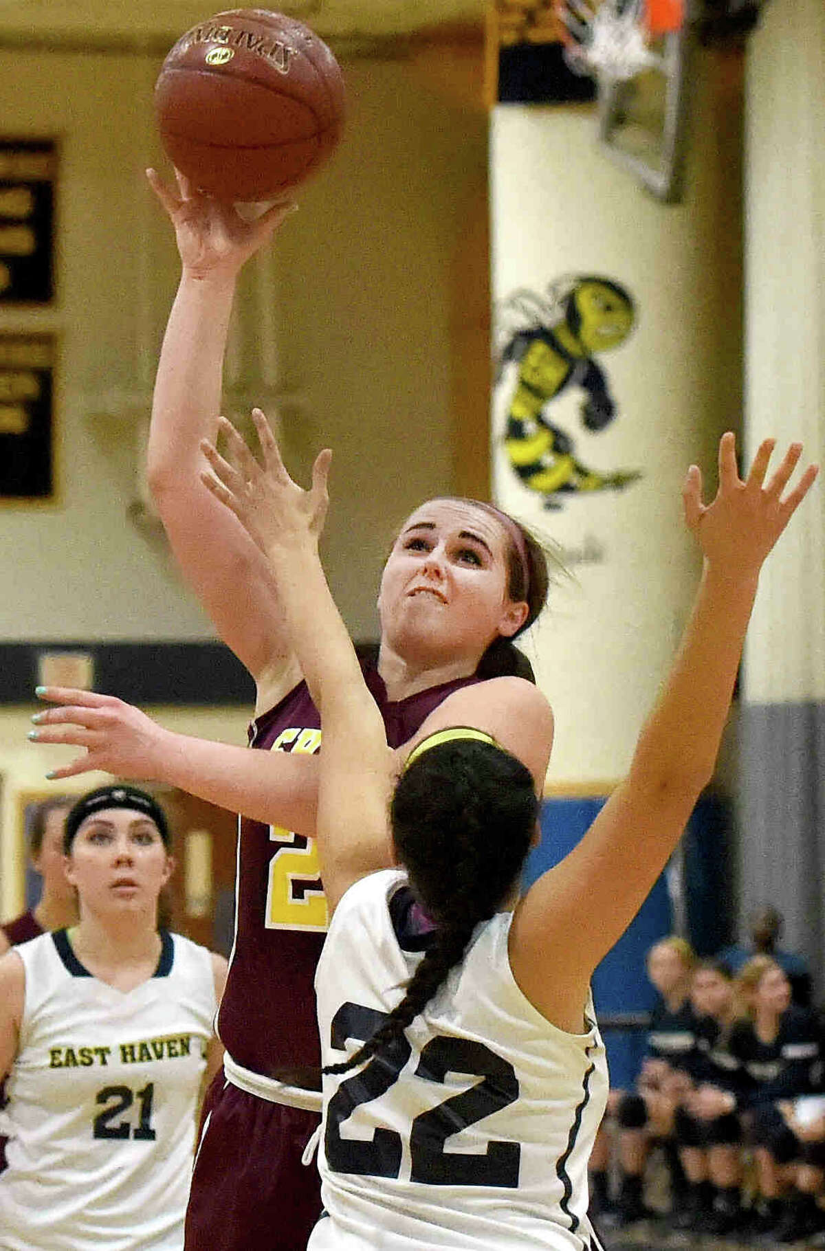 (Photo by Peter Hvizdak - New Haven Register) Kaitlin Lagasie of Sheehan H.S. takes a shot over Dana Ross of East Haven H.S. during fourth quarter girls basketball action at East Haven H.S. Wednesday, December 10, 2014.
