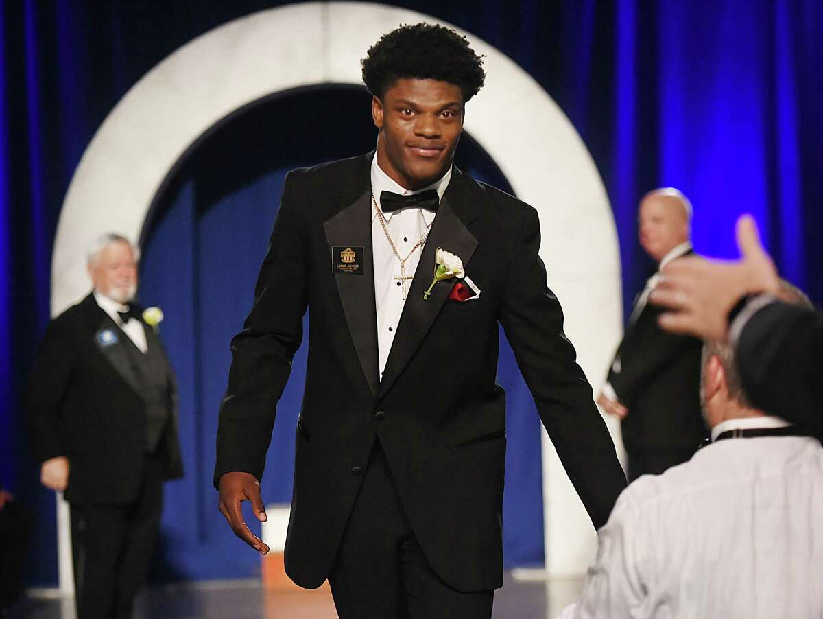Louisville quarterback Lamar Jackson and Heisman Trophy winner is introduced as the Walter Camp Football Foundation's 2016 Player of the Year at the 50th annual national awards banquet on Saturday, January 14, 2017, at the Yale University Commons in New Haven. (Catherine Avalone/New Haven Register)