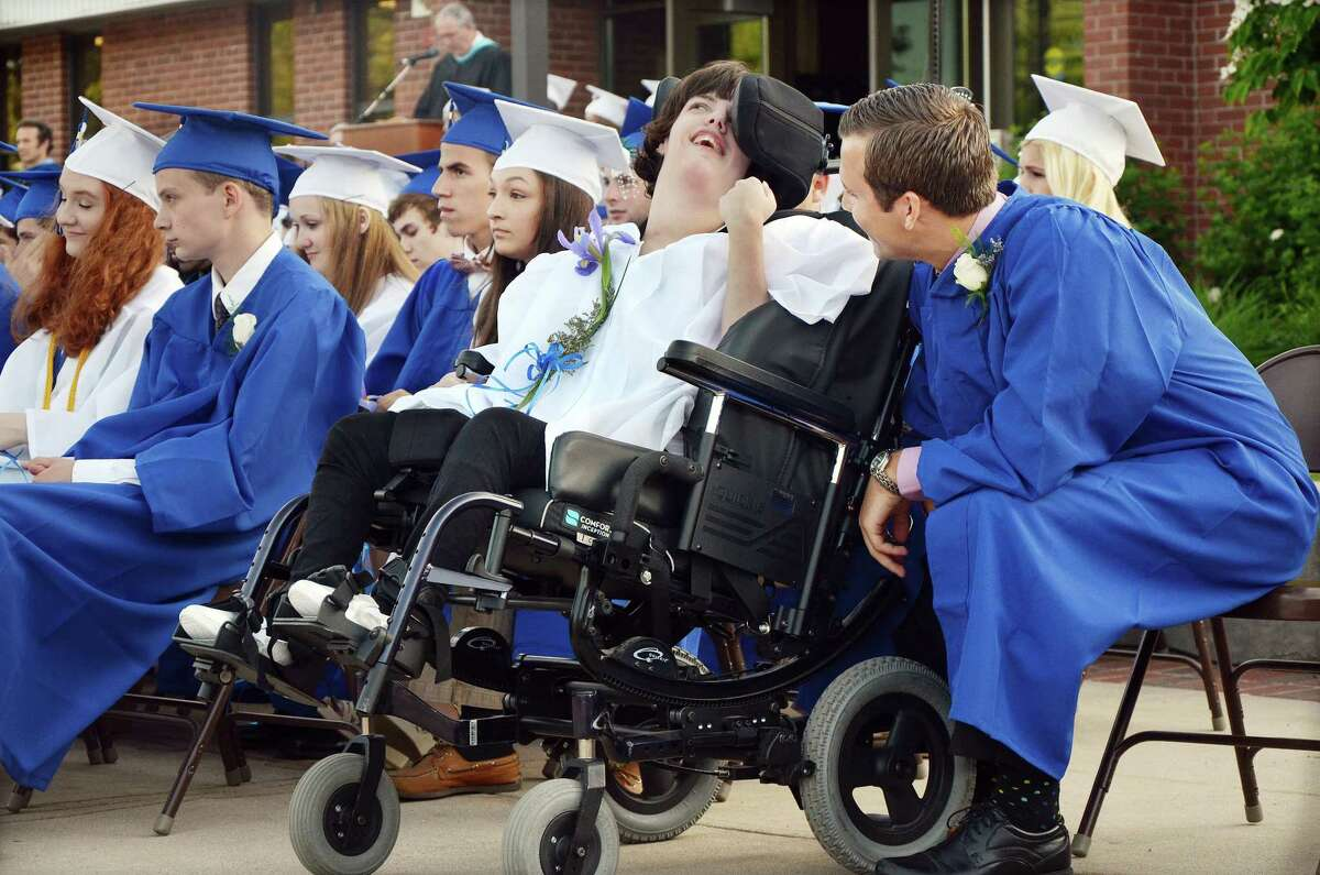 June 18, 2014 - East Hampton High School junior Nick Barber shares a moment with Nicole Race shortly before he takes her up to receive her diploma at the 76th commencement exercises at East Hampton High School Wednesday evening. (Catherine Avalone/The Middletown Press)
