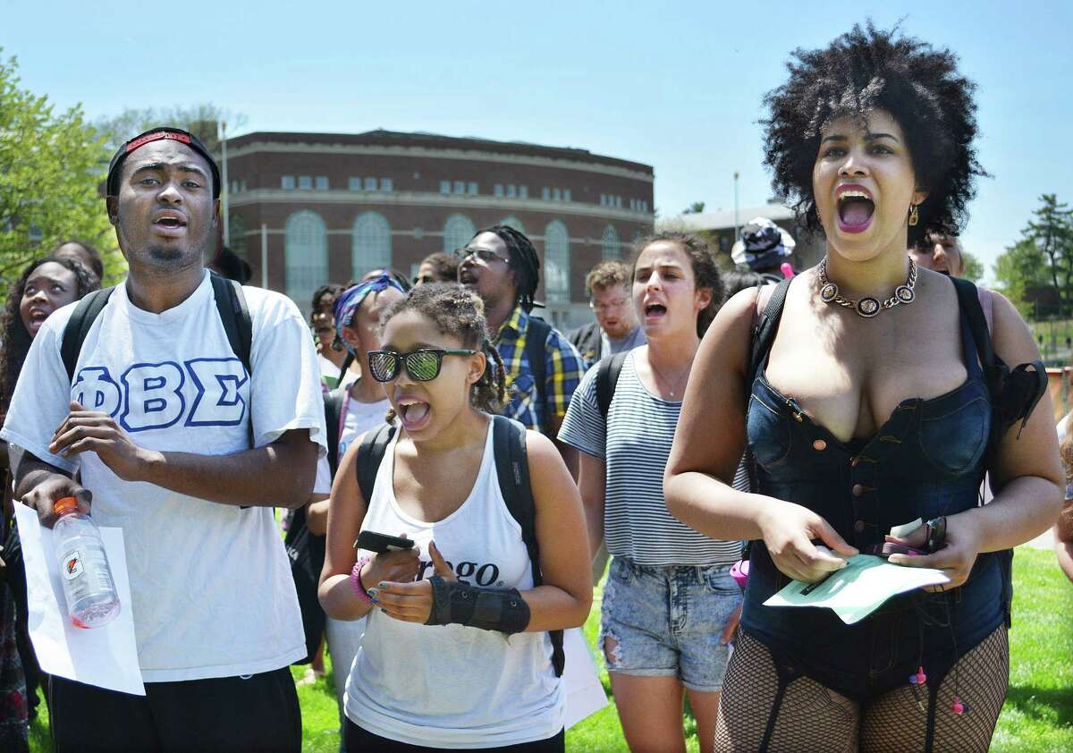 May 12, 2014 - Wesleyan University students Eurton Laidley, Crystal Franklin, and Karmenije Paulino protest the possiblilty of deep cuts in the African American Studies program Monday afternoon. (Catherine Avalone/The Middletown Press)