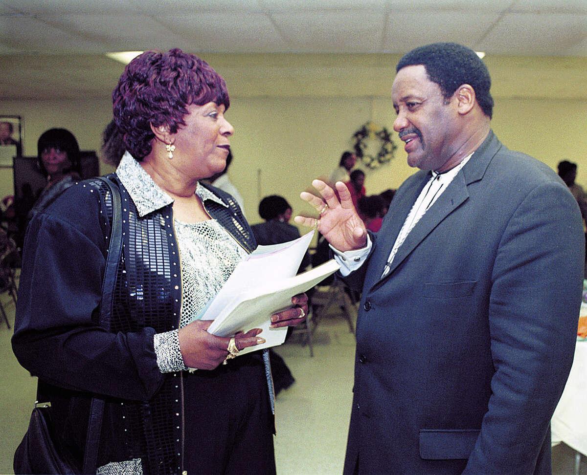 March 30, 2002 - Jacqueline Johnson, Gospel Promoter for the New England Gospel Association, speaks with Shiloh Baptist Church Pastor Rev. W. Vance Cotten at the church.