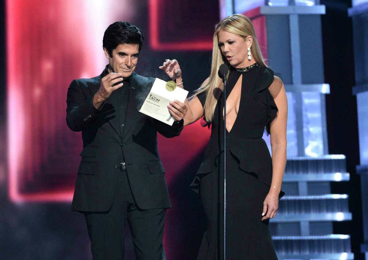 The award envelope smokes as David Copperfield, left, and Nancy O'Dell present the award for song of the year at the 52nd annual Academy of Country Music Awards at the T-Mobile Arena on Sunday, April 2, 2017, in Las Vegas.