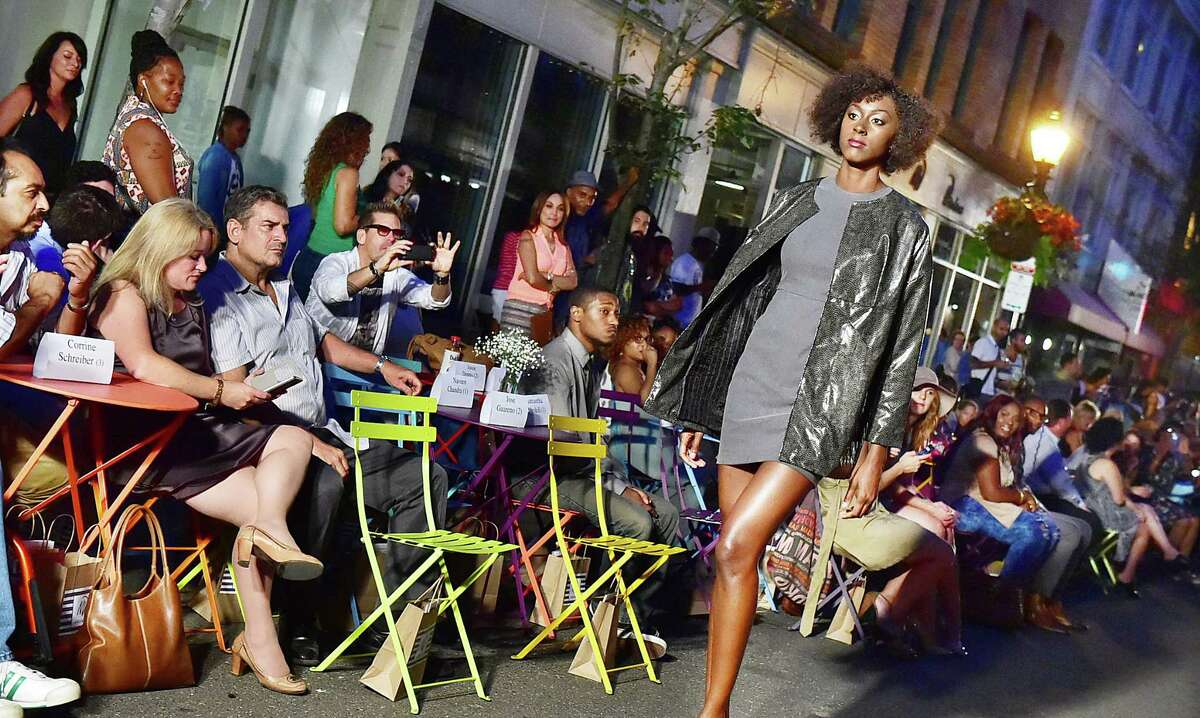 Models walk the runway on Orange Street in New Haven at the 4th annual Neville Wisdom Fall Collection, Friday, September 4, 2015. (Catherine Avalone/New Haven Register)