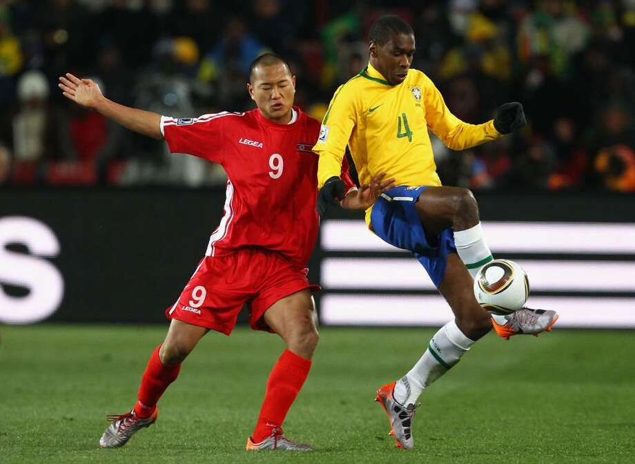 JOHANNESBURG, SOUTH AFRICA - JUNE 15:  Jong Tae-Se of North Korea and Juan of Brazil battle for the ball during the 2010 FIFA World Cup South Africa Group G match between Brazil and North Korea at Ellis Park Stadium on June 15, 2010 in Johannesburg, South Africa.  (Photo by Richard Heathcote/Getty Images) *** Local Caption *** Jong Tae-Se;Juan Photo: Richard Heathcote, Getty Images / 2010 Getty Images