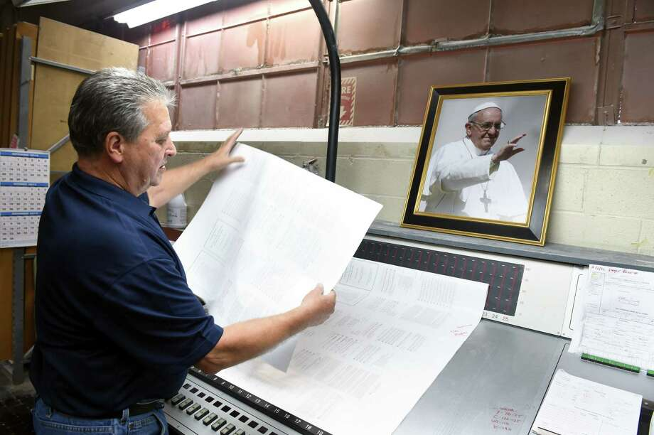 The Knights of Columbus printing plant in New Haven, Connecticut, prints some of the 350,000 Papal Mass programs on 9/16/2015 that will be used at the closing of the World Meeting of Families in Philadelphia on 9/27/2015.   Photo by Arnold Gold/New Haven Register   agold@newhavenregister.com