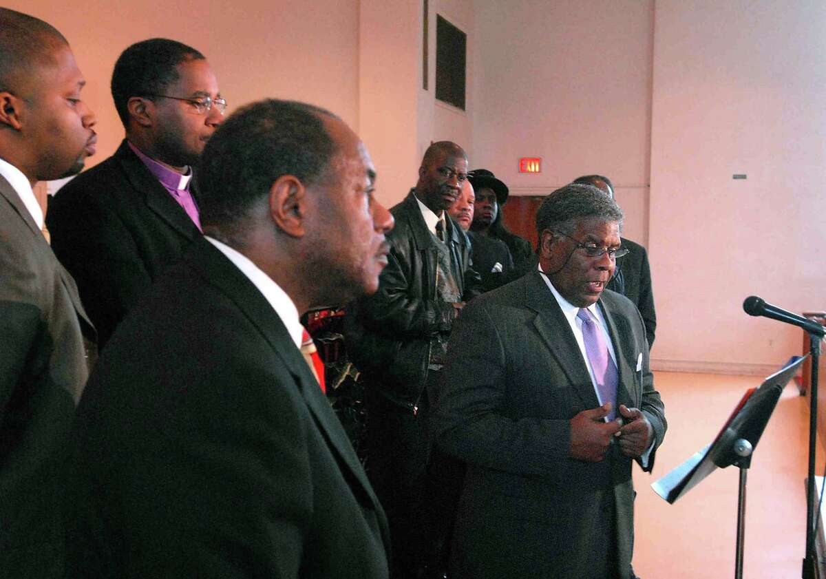 """Reg0701 Photo-Peter Casolino 01/01/07 New Haven--Former New Haven Mayor John C. Daniels along with other community leaders and clergy spoke about a new initiative called the """"Zero Killing Campaign"""" aimed at curbing youth murders in New Haven. In the foreground is James Newton. Photo -Peter Casolino"""