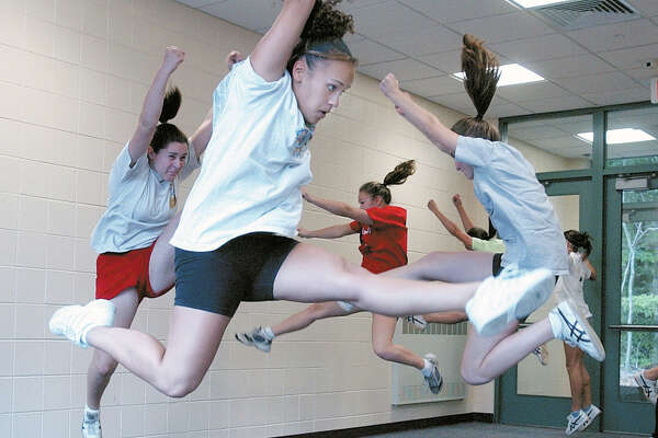 Vanessa Valentin (cq) and the rest of the Cromwell High School soccer cheerleaders practice in the school's hallway on Thursday. The gym is currently being used as storage until construction is completed...........TW photo.............100302