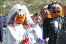 Samantha DeGroff, 10, of Berlin and Annie Kirklin, 4, of West Hartford join the wedding party at Pumpkintown in East Hampton this week...............Tom Warren Photo............101502