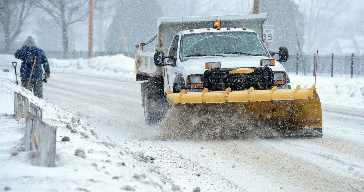 (Arnold Gold-New Haven Register) A plow clears snow on River Rd. in Shelton on 2/9/2015.