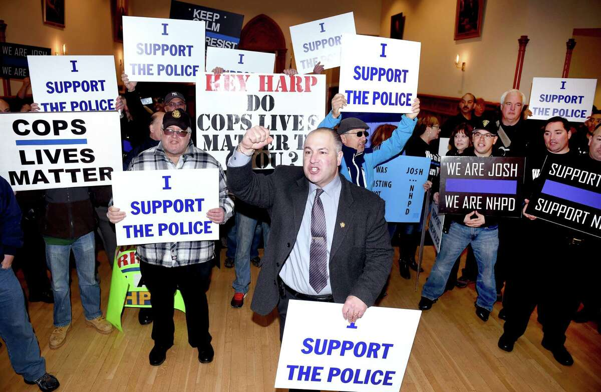 New Haven Police Union President Louis Cavaliere, Jr., (center) leads a Pro-Police Rally into City Hall in New Haven interrupting a press conference announcing the exoneration of New Haven Police Officer Joshua Smereczynsky on 3/27/2015. Photo by Arnold Gold/New Haven Register agold@newhavenregister.com