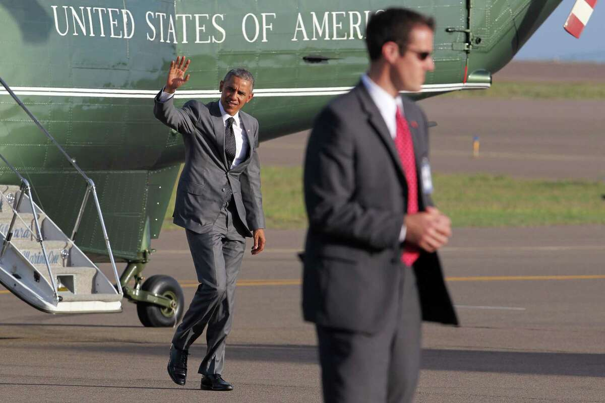 President Barack Obama waves and walks away from Marine One as he arrives to Norman Manley International Airport, shortly before departing Kingston, Jamaica, Thursday, April 9, 2015. Obama is departing Jamaica on Thursday for Panama, where he will attend the Summit of the Americas that starts Friday.