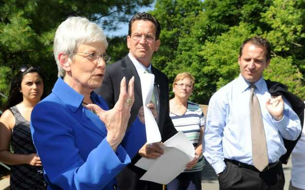 Democratic gubernatorial candidate Dan Malloy, center with running mate Nancy Wyman were at Danbury CTWorks Tuesday, to share their plans for growing jobs in Connecticut and revitalizing the state's economy. Right is state Rep. Joe Taborsak. Photo taken Tuesday, June 15, 2010. Photo: Carol Kaliff / The News-Times