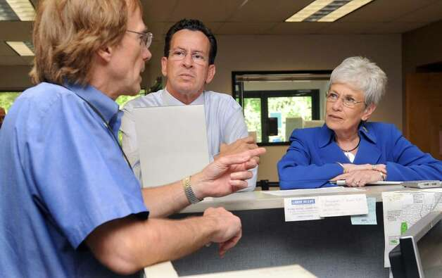 Dan Malloy, center and running mate Nancy Wyman, the Democratic Party's endorsed candidates for governor and Lt. governor, visit the Danbury CTWorks Center Tuesday, June 15, 2010. They are speaking with Brian Douglas of Brookfield, left, a programs and services coordinator. Photo: Carol Kaliff / The News-Times