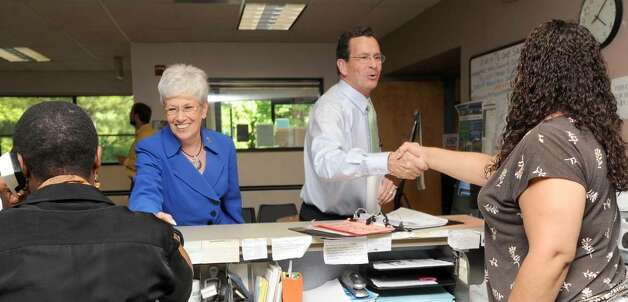 Dan Malloy, right and Nancy Wyman, the Democratic Party's endorsed canndidates for governor and Lt. governor, visit the Danbury CTWorks Center on West Street. Tuesday, June 15, 2010. Left is employee Shirley Nwachakwu and right is Roberta Manzano. Photo: Carol Kaliff / The News-Times