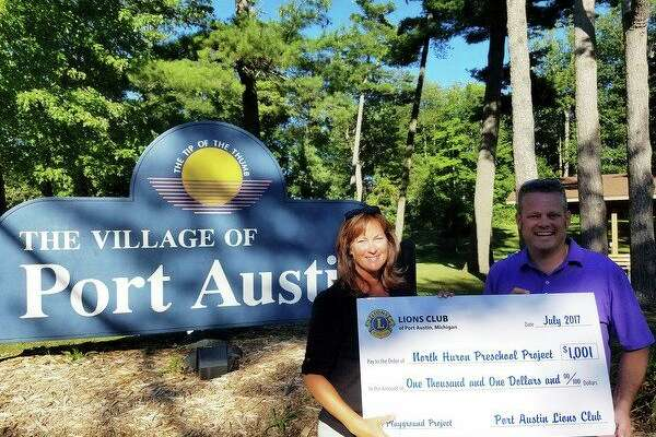 Lion's Club President Casey Bruce recentlypresented a check toNorth Huron Great Start Readiness Programpreschool director Ellen Yarochto support North Huron's Preschool Playground Project. (Submitted Photo)