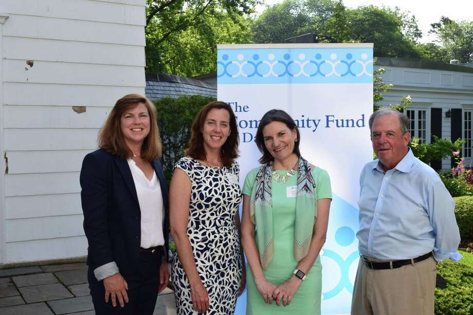Pictured are Community Fund Executive Director Carrier Bernier, Building One Community Executive Director Catalina Horak, Community Fund Grants Director Lisa Haas, and Steve Ward, Community Fund Board President. Photo: Building One Community