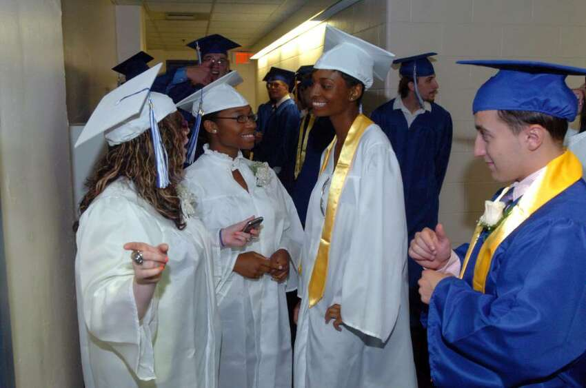 Students and family attend the Henry Abbott Technical High School graduation at the O'Neill Center on Western Connecticut State University's campus in Danbury, June 15, 2010.