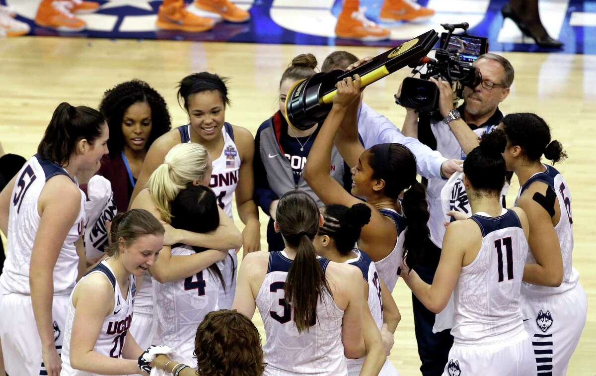 Members of Connecticut celebrate after defeating Syracuse in the championship game at the women's Final Four in the NCAA college basketball tournament Tuesday, April 5, 2016, in Indianapolis. Connecticut won 82-51.