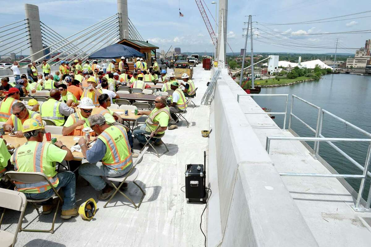 Construction workers celebrate the completion of southern half of the Pearl Harbor Memorial Bridge that they worked on with a barbecue lunch on top of the bridge in New Haven on 7/17/2015. Photo by Arnold Gold/New Haven Register agold@newhavenregister.com