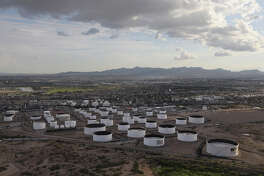 EL PASO, TX - AUGUST 01:  An oil refinery and tanks stand near the U.S.-Mexico border on August 1, 2017 in El Paso, Texas. San Antonio based Tesoro purchased Western Refining in June, renaming the combined companies Andeavor. (Photo by John Moore/Getty Images)
