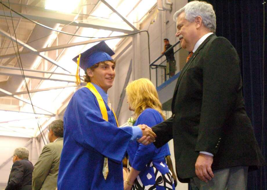 Raphael Carvalho shakes state representative Bob Godfrey's hand after receiving his diploma during the Henry Abbott Technical High School graduation at the O'Neill Center on Western Connecticut State University's campus in Danbury, June 15, 2010. Photo: Chris Ware / The News-Times