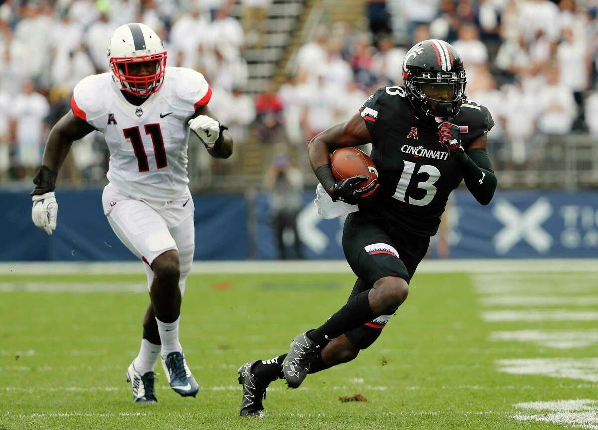 Cincinnati wide receiver Avery Johnson runs past Connecticut linebacker Junior Joseph (11) during the first half of an NCAA college football game Saturday, Oct. 8, 2016, in East Hartford, Conn.
