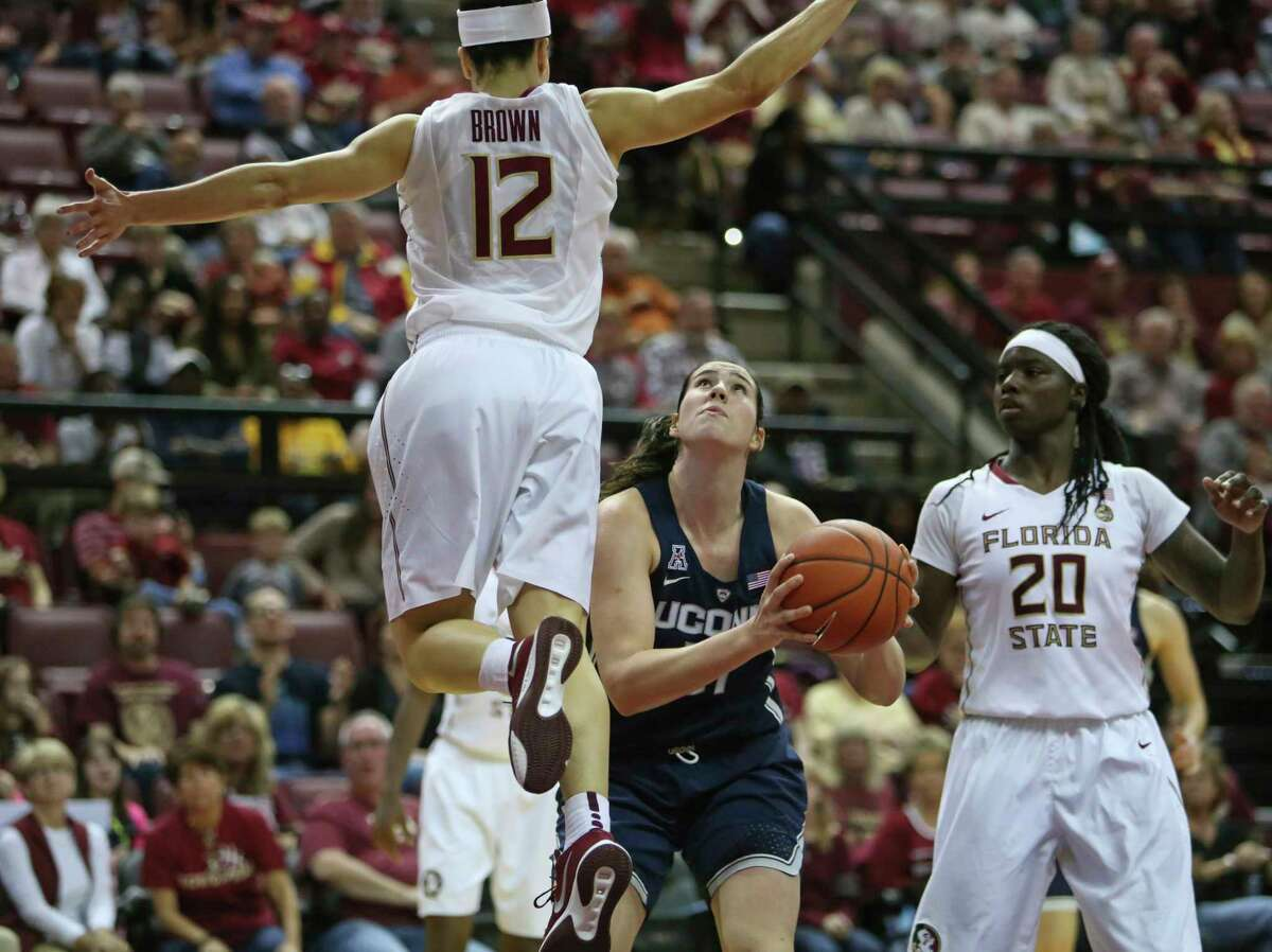 Connecticut's Natalie Butler eyes the basket and waits for a high flying Brittany Brown of Florida State to pass before taking the shot in the second quarter of an NCAA college basketball game, Monday, Nov. 14, 2016, in Tallahassee, Fla. UConn won the game 78-76.